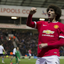 Manchester United's Marouane Fellaini celebrates after scoring during the English FA Cup Fifth Round soccer match between Preston and Manchester United at Deepdale Stadium in Preston, England, Monday Feb. 16, 2015. (AP Photo/Jon Super)
