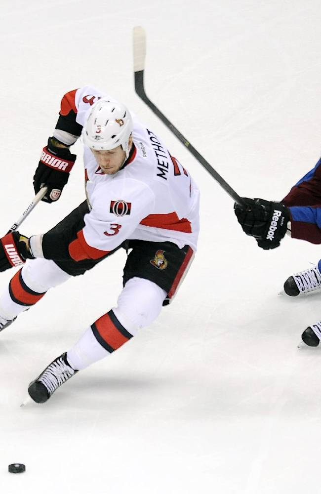Ottawa Senators defenseman Marc Methot, left, and Colorado Avalanche center Matt Duchene, right, battle for the puck in the first period of an NHL hockey game on Wednesday, Jan. 8, 2014, in Denver