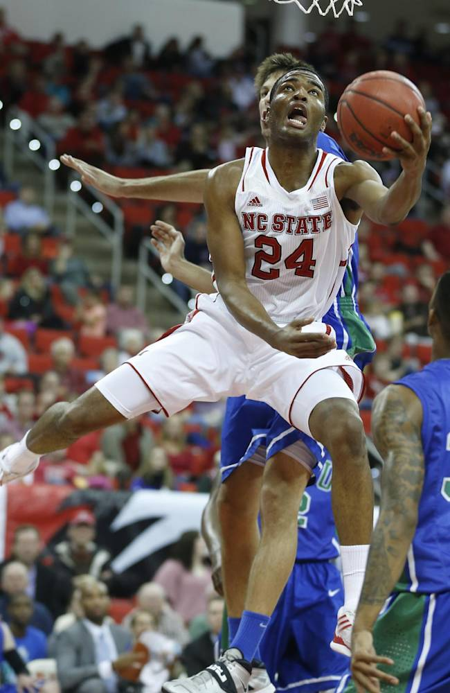 North Carolina State's T.J. Warren (24) shoots Florida Gulf Coast during the first half of an NCAA college basketball game at PNC Arena in Raleigh, N.C., Tuesday, Nov. 26, 2013
