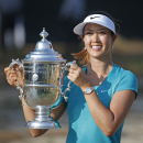 Michelle Wie poses with the trophy after winning the U.S. Women�s Open golf tournament in Pinehurst, N.C</td></tr>