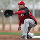 Cincinnati Reds first baseman Joey Votto catches a ball during spring training baseball practice in Goodyear, Ariz., Tuesday, Feb. 25, 2014 The Associated Press