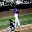 Chicago White Sox's Blake Tekotte is safe at third under Colorado Rockies third baseman Paul Janish advancing on an overthrow during the fourth inning of a spring exhibition baseball game in Scottsdale, Ariz., Sunday, March 23, 2014 The Associated Press
