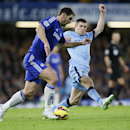 Chelsea's Branislav Ivanovic, left, competes for the ball with Manchester City's James Milner during the English Premier League soccer match between Chelsea and Manchester City at Stamford Bridge stadium in London, Saturday, Jan. 31, 2015