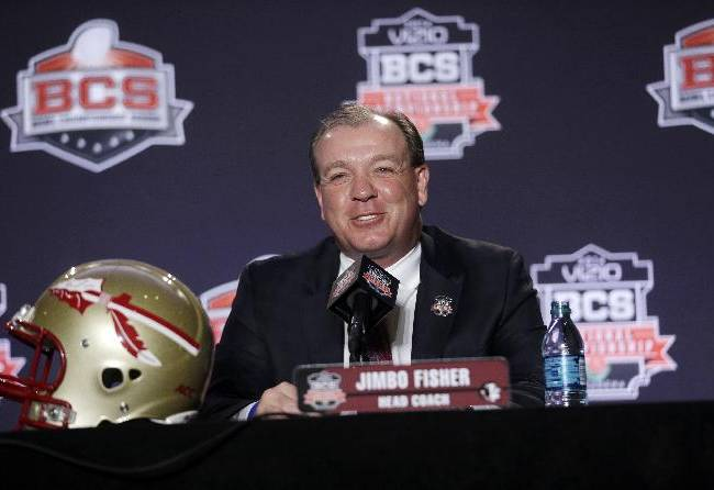 In this Jan. 6, 2014, file photo, Florida State head coach Jimbo Fisher answers a question during a news conference for the NCAA BCS National Championship college football game in Newport Beach, Calif. Fisher will addresses the media for the first time since Signing Day on Thursday, March 6