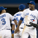 Toronto Blue jays Maicer Izturis, left,  and Rajai Davis, right, celebrate after defeating the Colorado Rockies in a baseball game in Toronto on Monday June 17, 2013. Izturis had the game winning single to score Davis.   (AP Photo/The Canadian Press, Frank Gunn)