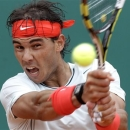 FILE - In this April 19, 2013 file photo, Spain's Rafael Nadal plays a return...</p>