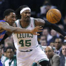 Detroit Pistons guard Kentavious Caldwell-Pope (5) and Boston Celtics forward Gerald Wallace (45) compete for a loose ball in the first half of an NBA basketball game in Boston, Wednesday, Dec. 18, 2013. (AP Photo/Elise Amendola)
