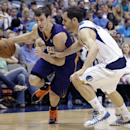 Phoenix Suns guard Goran Dragic, left, of Slovenia, drives against Dallas Mavericks guard Jose Calderon, right, of Spain, during the first half of an NBA basketball game on Saturday, April 12, 2014, in Dallas The Associated Press