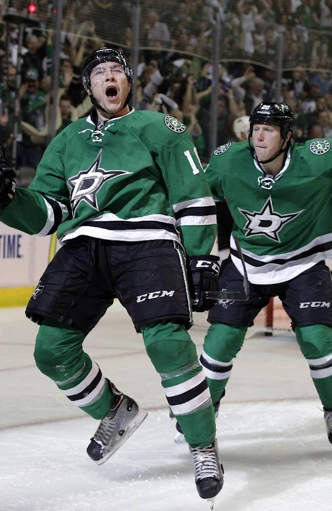 Dallas Stars' Ryan Garbutt (16) celebrates his goal with Cody Eakin (20) against the Anaheim Ducks in the third period of Game 3 of a first-round NHL hockey Stanley Cup playoff series game, Monday, April 21, 2014, in Dallas. The Stars won 3-0