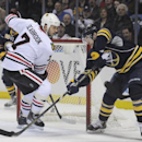 Buffalo Sabres' Drew Stafford, right, backhands the puck for a first-period goal as Chicago Black Hawks' Brent Seabrook arrives too late during the first period of an NHL hockey game in Buffalo, N.Y., Sunday, March 9, 2014 The Associated Press
