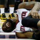 ATLANTA, GA - MAY 20: DeMarre Carroll #5 of the Atlanta Hawks reacts after injuring his left leg in the fourth quarter against the Cleveland Cavaliers during Game One of the Eastern Conference Finals of the 2015 NBA Playoffs at Philips Arena on May 20, 2015 in Atlanta, Georgia. (Photo by Kevin C. Cox/Getty Images)