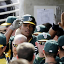 Oakland Athletics' Michael Taylor is congratulated in the dugout after hitting a home run during the second inning of an exhibition spring training baseball game against the Milwaukee Brewers, Wednesday, March 5, 2014, in Phoenix The Associated Press