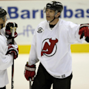 New Jersey Devils right wing Jaromir Jagr, right, of the Czech Republic, talks to Travis Zajac during NHL hockey training camp, Friday, Sept. 19, 2014, in Newark, N.J The Associated Press