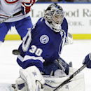 Tampa Bay Lightning goalie Ben Bishop makes a save on a shot by the Montreal Canadiens during the third period of an NHL hockey game Tuesday, April 1, 2014, in Tampa, Fla. The Lightning won 3-1 The Associated Press