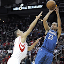 Minnesota Timberwolves' Kevin Martin (23) shoots over Houston Rockets' Jeremy Lin, left, in the first half of an NBA basketball game Saturday, Nov. 23, 2013, in Houston The Associated Press