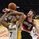Portland Trail Blazers center Joel Freeland, right, of England, knocks the ball from the hands of Los Angeles Lakers forward Xavier Henry during the second half of an NBA basketball game, Sunday, Dec. 1, 2013, in Los Angeles The Associated Press