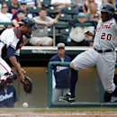 Detroit Tigers' Rajai Davis (20) is safe at home as Atlanta Braves catcher Christian Bethancourt cannot handle the throw in the sixth inning of a spring exhibition baseball game on Wednesday, Feb. 26, 2014, in Kissimmee, Fla. The Tigers won 6-5 The Associ