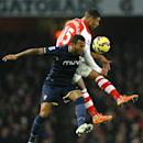 Arsenal's Alex Oxlade-Chamberlain, behind, vies for the ball with Southampton's Ryan Bertrand during the English Premier League soccer match between Arsenal and Southampton at Emirates stadium in London, Wednesday, Dec. 3, 2014