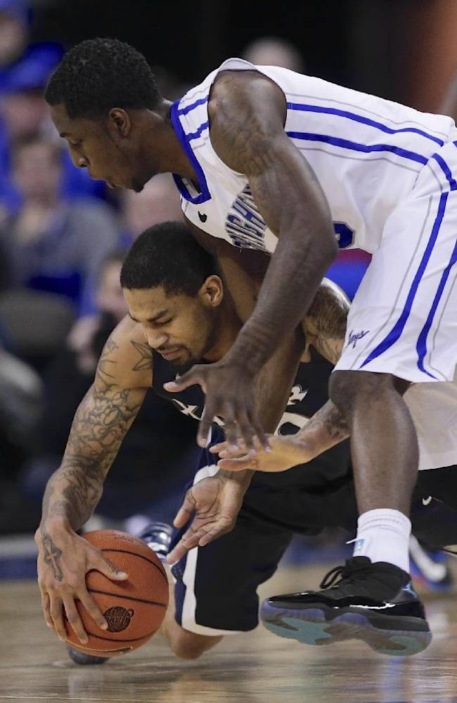 Xavier's Semaj Christon, bottom, and Creighton's Devin Brooks, top, go for a loose ball in the first half of an NCAA college basketball game in Omaha, Neb., Sunday, Jan. 12, 2014