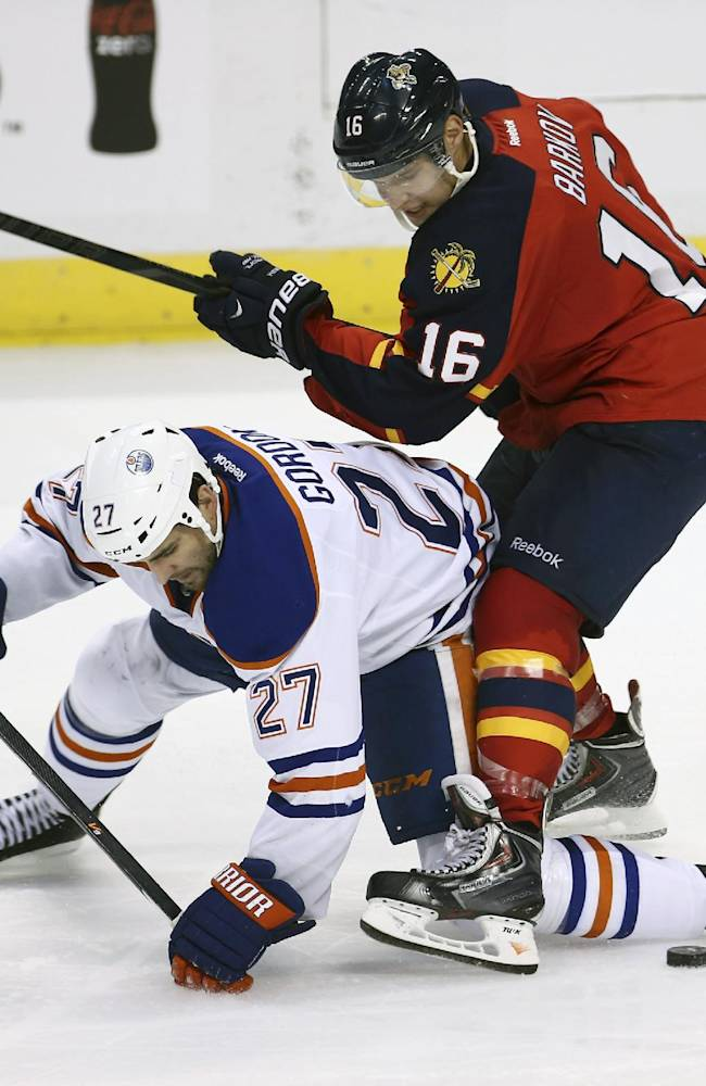 Florida Panthers' Aleksander Barkov (16) and Edmonton Oilers'Boyd Gordon (27) battle for the puck during the second period of an NHL hockey game in Sunrise, Fla., Tuesday, Nov. 5, 2013