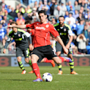 Cardiff City's Peter Whittingham scores his side's first goal of the game during their English Premier League soccer match against Stoke City at the Cardiff City Stadium, Cardiff, Wales, Saturday, April 19, 2014