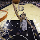 San Antonio Spurs' Tim Duncan (21) shoots as Indiana Pacers' Luis Scola, left, and Orlando Johnson, right, are near during the first half on an NBA basketball game Saturday, Dec. 7, 2013, in San Antonio The Associated Press