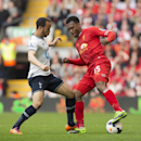 Liverpool's Daniel Sturridge, right, fights for the ball against Tottenham's Andros Townsend during their English Premier League soccer match at Anfield Stadium, Liverpool, England, Sunday March 30, 2014