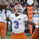 Florida quarterback Treon Harris (3) throws a pass during the first half of an NCAA college football game against Florida State in Tallahassee, Fla., Saturday, Nov. 29, 2014. (AP Photo/John Raoux)