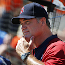 Boston Red Sox manager John Farrell gives signals during an exhibition baseball game against the Baltimore Orioles in Sarasota, Fla., Saturday, March 8, 2014 The Associated Press