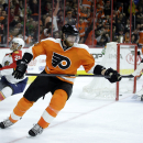 Philadelphia Flyers' Jakub Voracek, center, of the Czech Republic, skates past Florida Panthers' Vincent Trocheck, left, and Roberto Luongo after scoring a goal during the second period of an NHL hockey game, Thursday, Nov. 6, 2014, in Philadelphia. Phila
