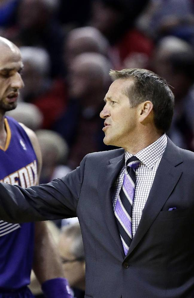 Phoenix Suns coach Jeff Hornacek, right, calls plays as Suns center Marcin Gortat walks to the bench during the first half of an NBA preseason basketball game in Portland, Ore., Wednesday, Oct. 9, 2013