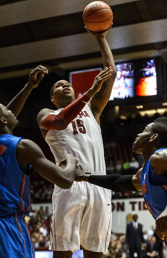 Alabama Forward Nick Jacobs (15) shoots over Florida forward Dorian Finney-Smith, left, during an NCAA college basketball game Thursday, Jan. 23, 2014, at Coleman Coliseum in Tuscaloosa, Ala