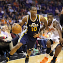 Utah Jazz guard Alec Burks (10) drives past Phoenix Suns guard Eric Bledsoe during the second half of an NBA basketball game on Saturday, Nov. 30, 2013, in Phoenix The Associated Press