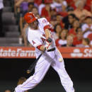 Los Angeles Angels' David Freese hits a three-run home run during the fifth inning of a baseball game against the Texas Rangers, Saturday, Sept. 20, 2014, in Anaheim, Calif. (AP Photo/Mark J. Terrill)