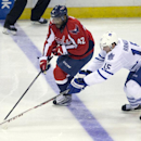 Washington Capitals right wing Joel Ward (42) fights against Toronto Maple Leafs defenseman Paul Ranger (15) for control of the puck during the third period of an NHL hockey game on Sunday, March 16, 2014, in Washington. The Capitals won 4-2 The Associate