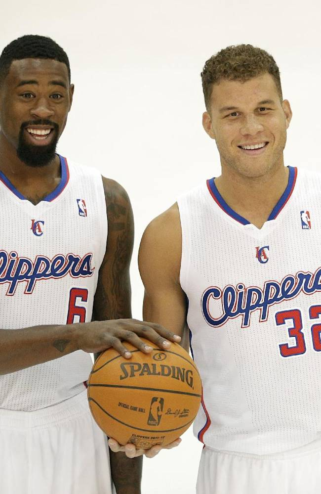 Los Angeles Clippers' DeAndre Jordan, left, and Blake Griffin pose for photos during the team's NBA basketball media day on Monday, Sept. 30, 2013, in Los Angeles