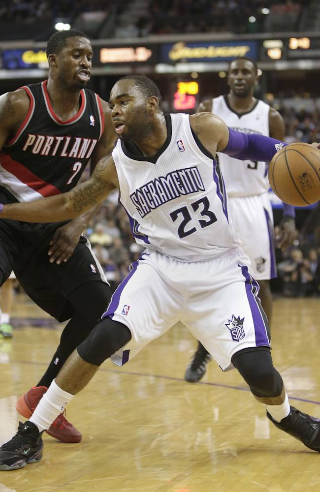 Sacramento Kings guard Marcus Thornton, right, drives against Portland Trail Blazers guard Wesley Matthews, left, during their NBA basketball game in Sacramento, Calif., Saturday, Nov. 9, 2013.  The Trail Blazers won 96-85