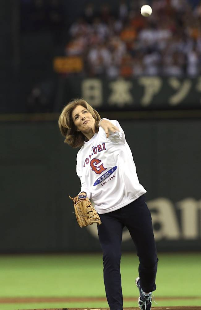 U.S. Ambassador to Japan Caroline Kennedy throws out the ceremonial first pitch before the Japan's Central League professional baseball opening game between the Yomiuri Giants and the Hanshin Tigers at Tokyo Dome in Tokyo, Friday, March 28, 2014