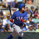 Texas Rangers' Shin-Soo Choo doubles against the Los Angeles Dodgers during an exhibition baseball game in Glendale, Ariz., Friday, March 7, 2014 The Associated Press