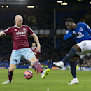 Everton's Romelu Lukaku, right, challenges West Ham United's James Collins during their English FA Cup third round soccer match at Goodison Park Stadium, Liverpool, England, Tuesday Jan. 6, 2015