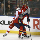 Florida Panthers' Aaron Ekblad (5) skates past Detroit Red Wings' Darren Helm (43) during the second period of an NHL hockey game in Sunrise, Fla., Tuesday, Jan. 27, 2015 The Associated Press
