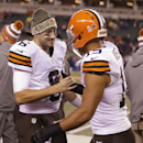 Cleveland Browns quarterback Brian Hoyer (6) is congratulated by Miles Austin (19) late in the second half of an NFL football game against the Cincinnati Bengals on Thursday, Nov. 6, 2014, in Cincinnati. The Browns won 24-3 The Associated Press