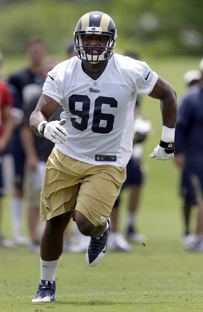 St. Louis Rams defensive end Michael Sam runs during an organized team activity at the NFL football team's practice facility Friday, June 6, 2014, in St. Louis