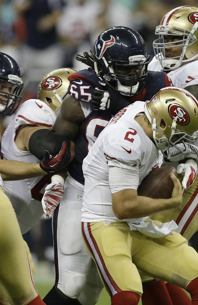 San Francisco 49ers' Blaine Gabbert (2) is caught behind the line of scrimmage by Houston Texans' Jason Ankrah (65) during the second quarter of an NFL football preseason game Thursday, Aug. 28, 2014, in Houston
