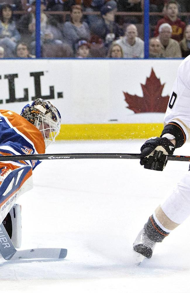 Anaheim Ducks Corey Perry (10) is stopped by Edmonton Oilers goalie Viktor Fasth (35) during first period NHL hockey action in Edmonton, Alberta, on Sunday April 6, 2014