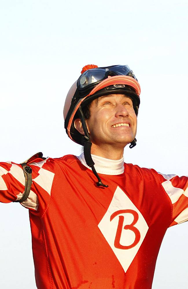 Roman Chapa reacts after riding Uneven Score to a win in the second horse race of the thoroughbred season opener at Lone Star Park at Grand Prairie, Texas, Thursday, April 10, 2014