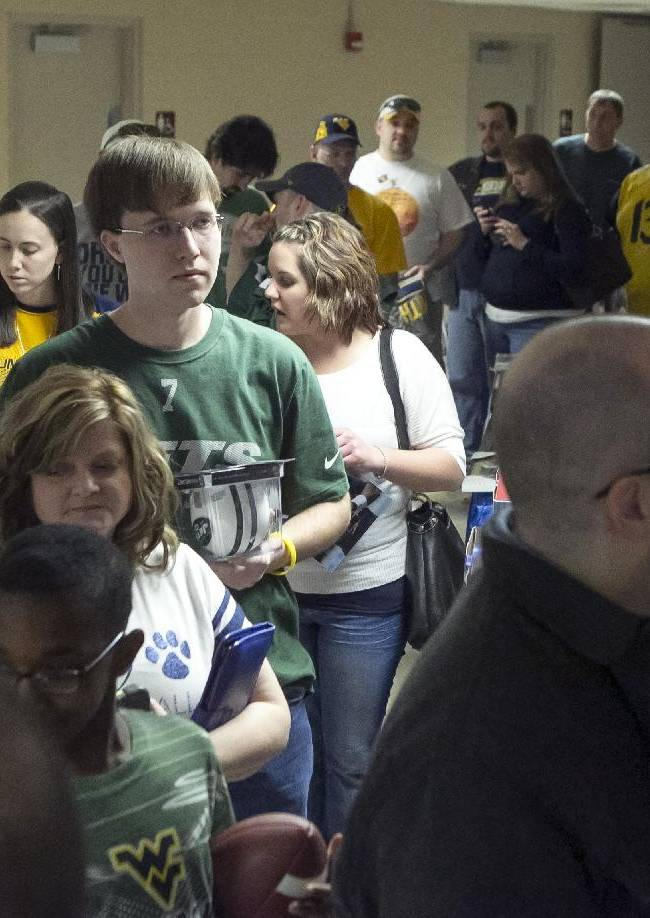 Fans lined up in the hallway waiting to see New York Jets quarterback Geno Smith at the Charleston Civic Center Saturday, March 22, 2014 in Charleston, WV