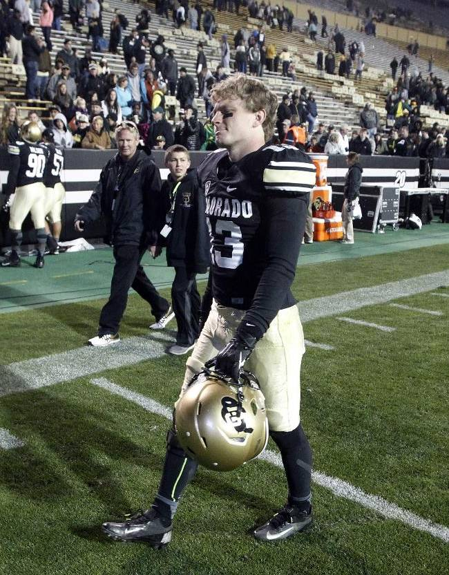 Colorado defensive back Parker Orms heads off the field after Oregon's 57-16 victory over Colorado in an NCAA college football game in Boulder, Colo., on Saturday, Oct. 5, 2013
