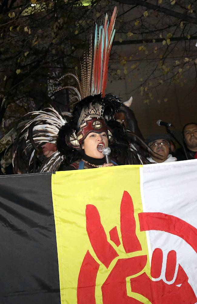 Several hundred American Indians and their supporters gather outside the Metrodome to protest the Washington Redskins' name, prior to an NFL football game between the Redskins and the Minnesota Vikings, Thursday, Nov. 7, 2013, in Minneapolis