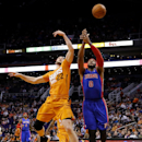 Phoenix Suns' Miles Plumlee (22) breaks up a pass for Detroit Pistons' Andre Drummond (0) during the first half of an NBA basketball game, Friday, March 21, 2014, in Phoenix The Associated Press